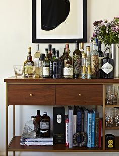 """#refinery29  http://www.refinery29.com/tina-ramchandani-nyc-apartment-design#slide-6  What are your secrets to creating a gorgeous bar cart?""""I love to style pieces so they look like part of the space, in addition to functioning as expected. A bar doesn't always have to look like a bar. This piece is actually an étagère we are using as a bar. I added books, plants, and objects to help this feel like a bookcase in addition to a bar cart. This also helped the bar ..."""