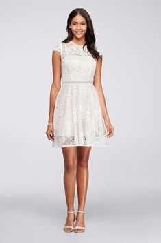 With delicate lace cap sleeves and a beaded waist, this short lace party dress is ready for any event. This style is exclusive to David\'s Bridal. By City Triangles Cotton, nylon, acetate Back zipp White Bridal Dresses, Lace Party Dresses, Little White Dresses, Event Dresses, Holiday Dresses, Bridesmaid Dresses, Bridal Lace, Dress Wedding, Dress Party