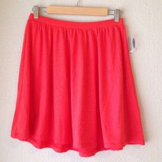 "Coral Red Circle Skirt Gorgeous vibrant red flowing circle skirt. Adds a great pop of color to any outfit. Made of soft cotton and has elastic waist, super comfy to wear. I love this skirt so much but it's just too big for me. I'm a size 0, would fit size 2-6 better.   Measurements: 14"" waist (laying flat), 17.5"" length. Condition: Brand new, never worn.  PayPal/Trades  Please ask any questions prior to purchasing. All sales final. Old Navy Skirts Circle & Skater"