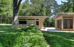 The detached garage was designed to echo the style of the home, from roof angle to building materials. Photo by MosbyBuildingArts.com