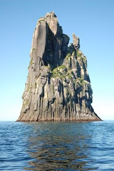 Basalt outcrop, off the island of Urup in the Kuril Islands, NW Pacific (Russian territory). I *think* this is real (??) - just a great photo of a piece of extraordinary geology (very similar to Devils Tower in Wyoming). Here's another photo: http://www.panoramio.com/photo/63231395
