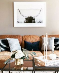 Love this! Modern living décor ideas | Tan leather couch | Tan and navy décor accents | Stripes | Sourced via @theeverygirl #wishtankworthy