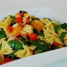 An easy pasta chicken salad showcases Asian flavors with mandarin oranges, fresh ginger, rice vinegar, and sesame oil.