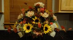 cemetery saddle autumn silk flowers arrangement headstone yellow sun flowers and chrysanthemums