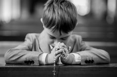 holy communion. boy. black and white. photography