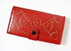 Genuine leather wallet in bifold style with snap button closure. The pattern in the wallet symbolizes the strength of an archer. Available in red color. Visit our ebay store at stores.ebay.com/shopatever for more details.