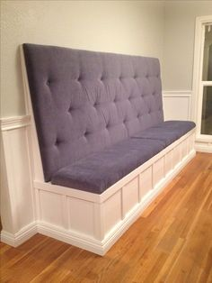 Built-in banquet. We needed more room in our small dining room so bench seating made the most sense. My wife Janell learned how to tuft the upholstery and chose some really nice micro suede material for easy clean up. We used extra thick foam (high density foam at 3 inches) for a comfy seat and back rest. I made the bench look built-in by using the same baseboard and wainscoting motif as the rest of the house #diy #banquette #diningroom Built In Dining Room Seating, High Back Dining Bench, Kitchen Banquette Seating, Kitchen Booth Seating, Dining Booth, Banquet Seating, Kitchen Booths, Bench Seat Dining Room, Kitchen Benches