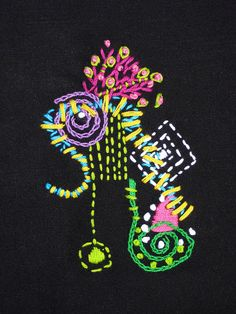 Free Form embroidery on black using chain, satin, seed, and french knots. For my free form embroidery I start by stitching one major element, and then add as I go to work from what I have already stitched. For me, it is like doodling - very slowly. Tips on how to get Seo tips more at http://www.seosucces.com/