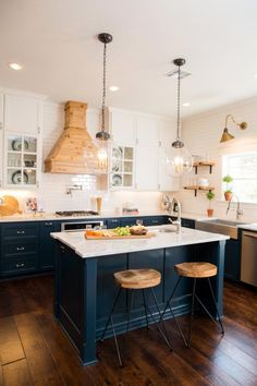 Fixer Upper: Old-World Charm for Newlyweds | HGTV's Fixer Upper With Chip and Joanna Gaines | HGTV Navy Blue Kitchen Cabinets, Diy Kitchen Cabinets, Kitchen Cabinet Colors, Kitchen Islands, Kitchen Counters, Wood Cabinets, White Cabinets, Kitchen Shelves, Sink On Island