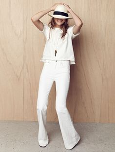 all-white // hat, frayed hem top and flared jeans #style #fashion