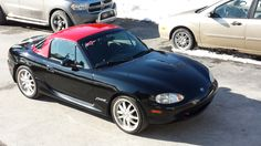 Black miata with Red hardtop