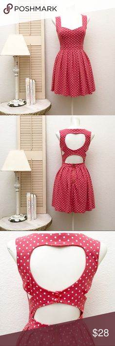 Tea & Cup Polkadot Dress with Heart Cut Out Jersey, 65% cotton 35% polyester. Sweetheart neckline.  Cut outs, see picture. Size: small. Length: approximately 31.5 inches from shoulder to hem. Chest: 14.5 inches measured lying flat. Waist: 12.5 inches measured lying flat. 7 inch exposed zipper at back of skirting. Stretch poly lining. This item is used and in very good condition.❤️ Color: soft red and white. Tea & Cup Dresses Mini