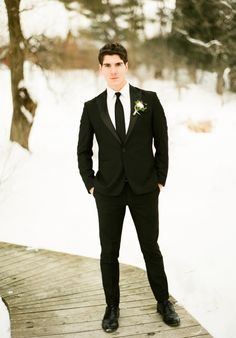Snow-Filled Winter Wedding Inspiration | great groom style | black suit