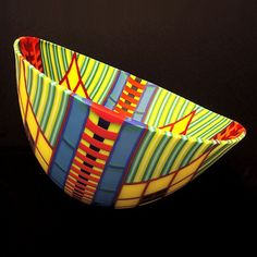 "Doug Randall, ""Cerrador II Basket"", 7.5""h, 14""w, 13.5""d. $3,600. His creations are spiritual in nature. A childhood fascination with stained glass cathedral windows is evident in monochromatic expanses punctured by ""windows"" into highly textured, multi-colored mosaic inlays that represent the many cultures, religions, races, of individuals experienced on his many journeys.  ""Windows"" provide a framework, point of view from which harmonious patterns of life can be considered & appreciated."