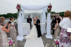 This traditional Chuppah is accented with wedding flowers!