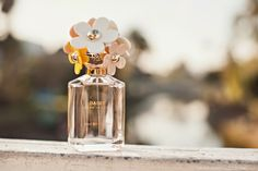How beautiful is this bottle.. Marc Jacobs Daisy http://www.stuffshelikes.net  http://rstyle.me/n/ibcehndjw #mjdaisychain