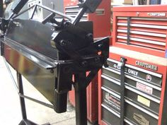 Sheetmetal Brake by Thiel-Metal-Fab -- Homemade sheetmetal brake with an integral stand fabricated from welded sheet steel and steel tubing. http://www.homemadetools.net/homemade-sheetmetal-brake-10