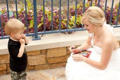 "On Disneyland bride Kristie's wedding day, a tiny tot approached her with his autograph book in tow- he thought she was a Disney princess (rightfully so, she looked stunning!) and was determined to get her autograph. Kristie of course obliged and singed ""Princess Bride Kristie"" in his memory book."
