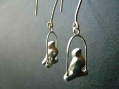 sterling silver swinging bird earring