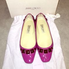 Jimmy Choo Fushia Flats Fushia patent leather with black stone beading details (front & back). Size 39.5 euro. Minor scuffs on interior from insoles I had attached. Front of shoes has the start of minor cracking (can only be seen up close). Jimmy Choo Shoes Flats & Loafers