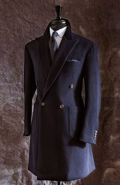 Perfectly tailored overcoat - I wish more guys I knew wore something like this.  If a flattering cut is chosen, it doesn't look stuffy, even on teenagers or young men.