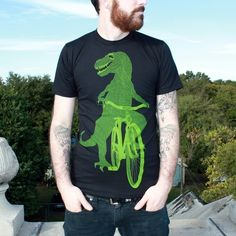 Dinosaur on a Bicycle - T Shirt