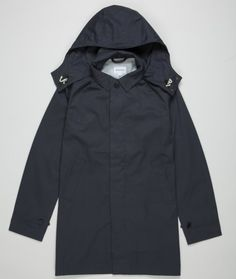 A long, two pocket rain coat featuring a concealed, removeable hood. The jacket is constructed using a waterproof Italian cotton twill, taped seams and an action back for improved movement.