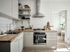 Contemporary Meets Cosy In a Swedish Apartment - Contemporary Meets Cosy In a Swedish kitchen with grey-beige cabinets and white subway tiles. Beige Kitchen, Kitchen Dining, Kitchen Decor, Kitchen Cabinets, Grey Kitchens, Modern Kitchens, Kitchen Modern, Kitchen Tips, Swedish Kitchen