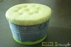 a DIY round ottoman. i'm doing this but i've thought of an easier way to do it than instructions here. plus, i'll cover the entire bucket with foam and fabric. round ottomans are just too expensive