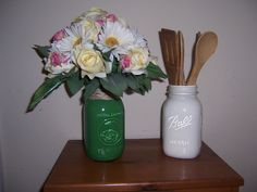 top green mason jar rapped in twine.using it as a vase for my wedding bouquet  white mason jar used as holder for wooden utensils