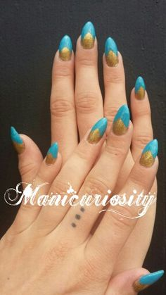 Wow! These turned out Amazing!!! They are a stiletto sculptured gel nail. I love this deep V nail design and the color combo pops! @Manicuriosity