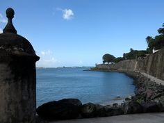 """Meeting Joaquin Bacardi in Puerto Rico -  I  point my camera towards the other side of the bay and scan the coastline. I stop as I see two wind turbines appear in my screen. I zoom in. """"There it is,"""" I say to myself. """"The largest rum distillery in the world!"""""""