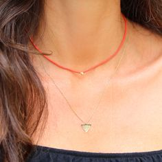 Red necklace and shark tooth necklace... Click on the photo to see the brands