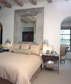 Rustic chic bedroom - enormous framed mirror headboard