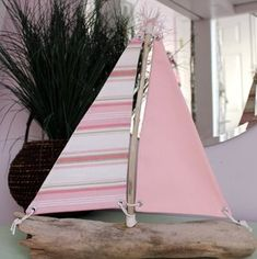 Love these cute handcrafted driftwood boats - would be perfect in a kids room!