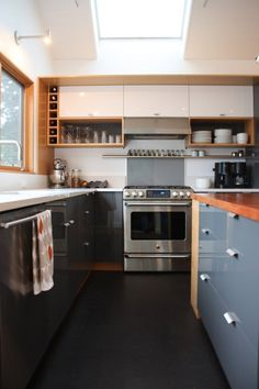 IKEA kitchen cabinets in color finishes to add contrast with wood. Love that gray blue