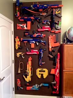 Nerf gun storage. $50 worth of materials, a couple of hours of work, and now no more Nerf Guns all over the floor!