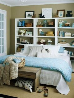 I love this idea! No need for bedside tables! Bookcase Headboard by georgette