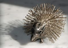 Antique silver hedgehog pincushion