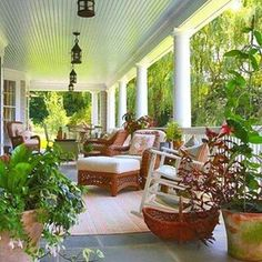 Gorgeous long and wide porch with comfortable furniture