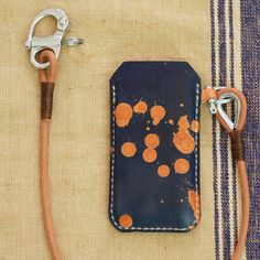 iPhone splatter case with leather leash #studiomunique #manufactur #handmade #leather #stuff #fashion #keyring #wallet #design #munich #denim #mensfashion #custom #orginal #handcrafted #qualitygoods #patina #artisan #keyfob # keychain #handstiched #graphic #moneyclip #madeingermany #love #sewing