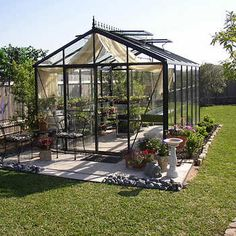 $6,000 + Royal Victorian Glass Greenhouse, black rims (use for hot tub or pool etc.)