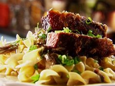 "BEEF STROGANOFF WITH BUTTERED NOODLES RECIPE: ~ From: ""Food Network.Com."" ~ Recipe Courtesy of Tyler FLORENCE (Tyler's Ultimate - Ultimate Beef Stroganoff) ~ Cook Time: 2 hrs, 35 min; Level: Easy; Yield: (4 to 6 Servings). (COOKED WITH BEEF SHORT RIBS)"