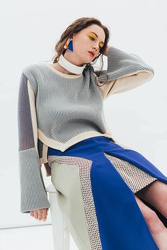 Combinations of the interesting touch of cutting line & details and Corky mixture of textile & colour is the signature of Moon J. Get to know this amazing designer from Korea.