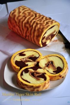 A popular cake flavour in Chinese Bakeries in America is the Tiger Roll. It has a coffee-flavoured golden-esque stripped outer appearance and is chocolate coloured with traditional white cream inside. It is similar to the look of a Tiger Bread or as known in Northern California, the Dutch Crunch Bread.