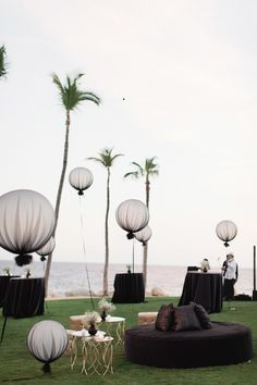 Chic and slightly edgy, oversize balloons covered in black tulle and floating at different heights add a gothic touch to this couple's oceanside cocktail hour. Pair the balloons with black table linens and lounge seating for a dark-yet-romantic vibe. Wedding Week, Wedding Set Up, Dream Wedding, Wedding Ideas, Wedding Trends, Wedding Reception, Wedding Venues, Tulle Balloons, Wedding Balloons