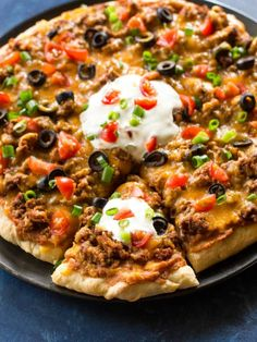 Taco Pizza – The Girl Who Ate Everything This Taco Pizza is Mexican meets Italian. Pizza dough topped with beans, salsa, beef, cheese, and all the toppings. the-girl-who-ate-… Taco Pizza Recipes, Beef Recipes, Cooking Recipes, Taco Recipe, Skillet Recipes, Cooking Tools, Italian Recipes, Mexican Food Recipes, Dinner Recipes