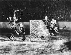 Photo Title  Wasted Effort  Photographer/Creator  Edward Feeney  Collection  1948  Publisher  Chicago Tribune  Caption/Description  Emile Francis, Chicago Blackhawk goalie, leaves the ice in an attempt to block a shot at the net. The puck sails harmlessly over Francis' head.