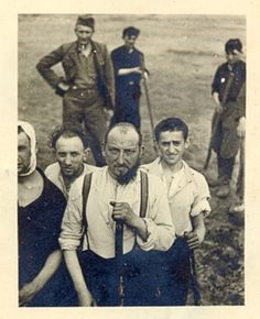 Polish Jews pose for a German camera.  The man directly in front has been shorn of half of his beard, while the man to his left looks to be wearing some remnant of clothing around his head, undoubtedly put there by a German tormenter.  The man wearing the hat behind the main group is dressed as a typical SS ethnic auxiliary, likely Hungarian, and a member of Einsatzgruppen A, which was active in the area of the Generalgouvernment.