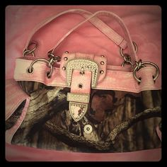 Pink and camo shoulder bag Nwot. Pink and camo bag with multiple interior pockets. My mother in law gave this to me, just isn't my style  Bags Shoulder Bags